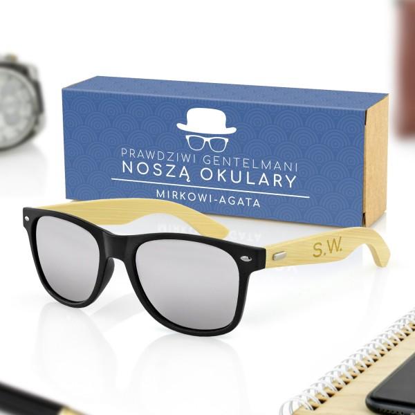 czarne okulary przeciwsłoneczne w pudełku z obwolutą na prezent dla niego