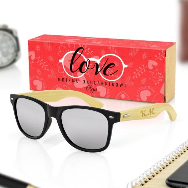 czarne okulary przeciwsłoneczne w pudełku z obwolutą na prezent dla niego na walentynki