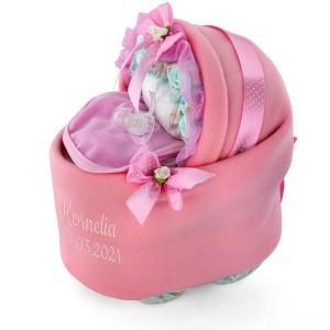 różowy wózek z pampersów