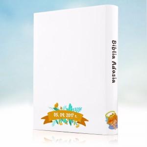 biblia z personalizowaną obwolutą na upominek z okazji chrztu