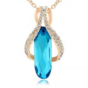naszyjnik z niebieskim kryształkiem i
