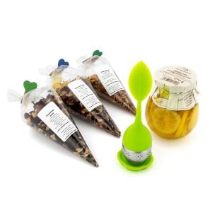 zestaw herbat z cytryną i zaparzacz