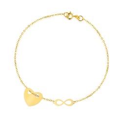 złote zawieszki na bransoletce: serce i znak nieskończoności